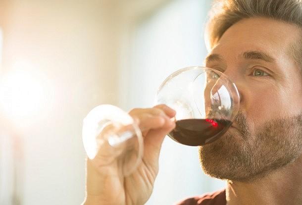 Holding Swigging Wine