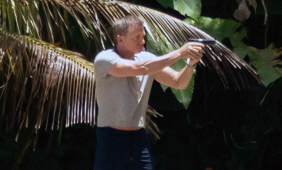 Bond 25 Set Photos Of Daniel Craig Have Surfaced & It's A Gun Show