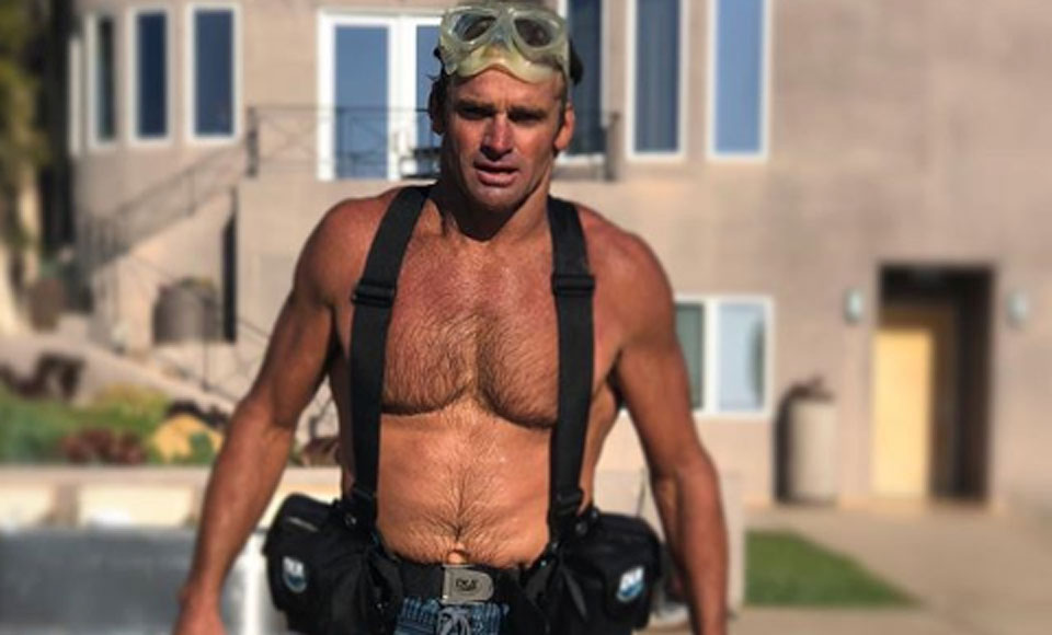 Six Packs Are An Overrated Fitness Fad & This Iconic Photo Of Big Wave Surfer Laird Hamilton Proves Why