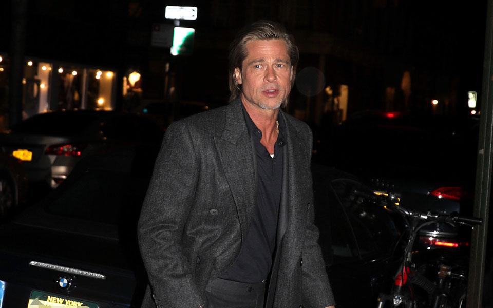 Brad Pitt Beats Wet Winter Weather & Still Looks A Million Bucks