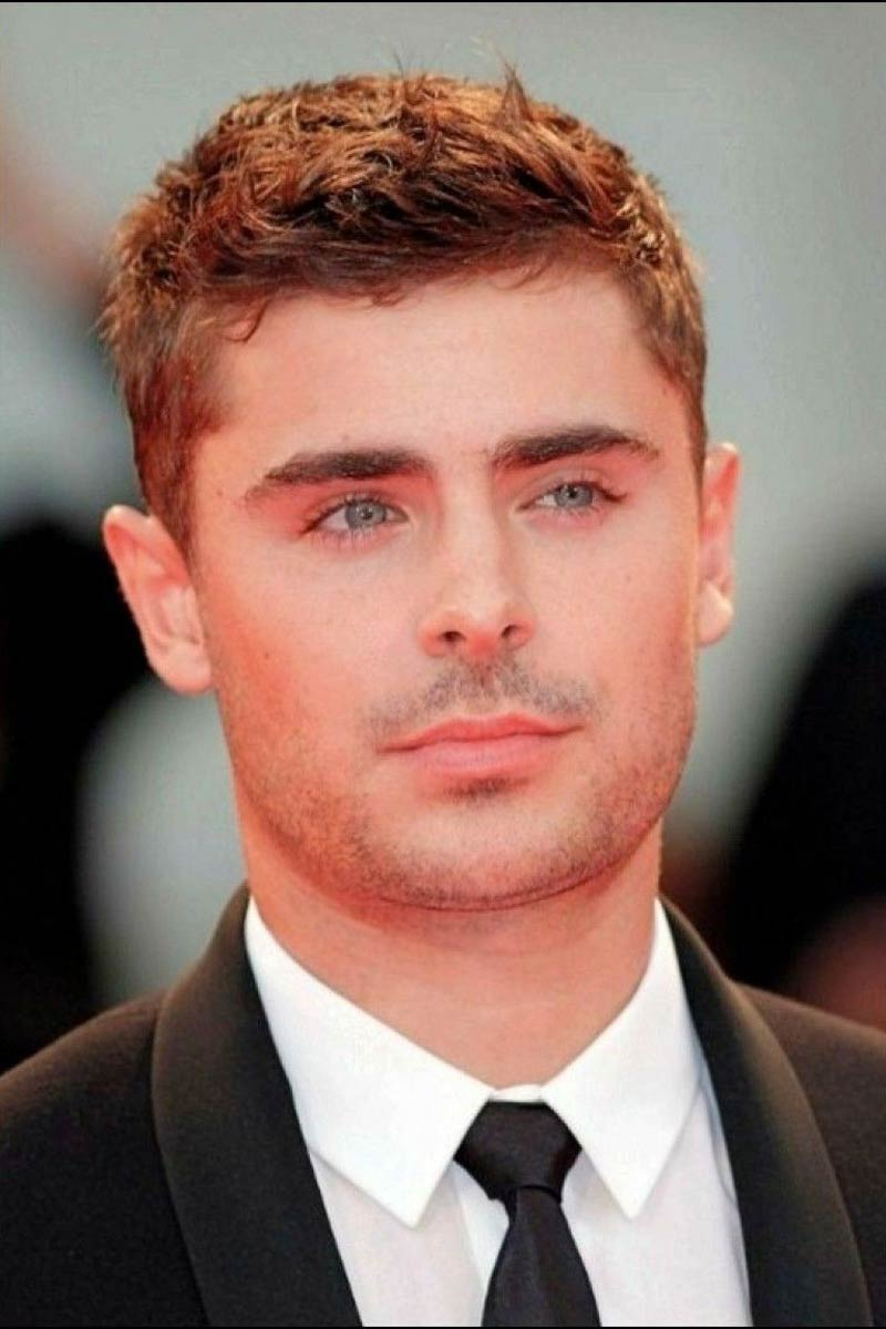 Zac Efron with short and messy haircut.