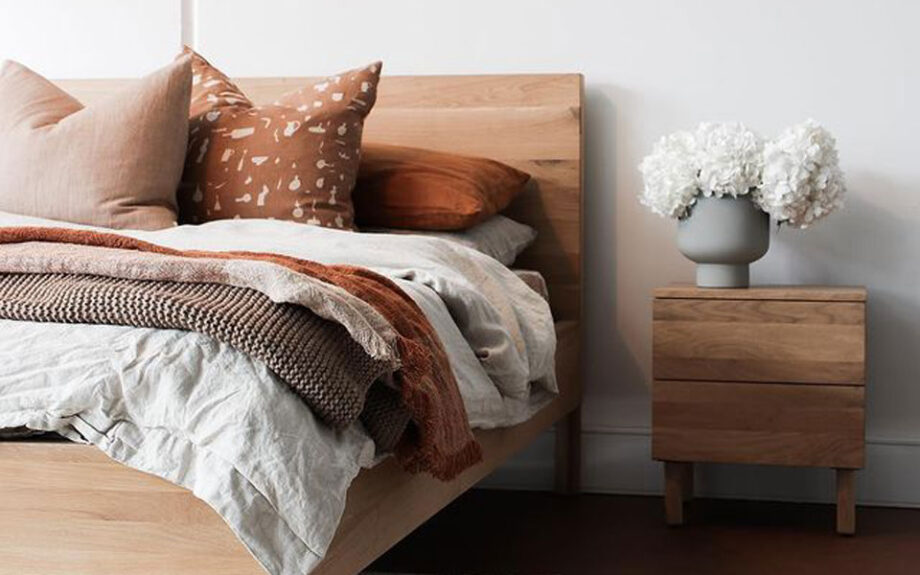 RJ Living wooden bed with matching side table, white and burnt orange bed linen